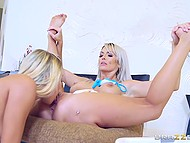 Golden-haired girlfriends actively rub shaved vaginas against each other on the soft carpet 4