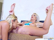 Golden-haired girlfriends actively rub shaved vaginas against each other on the soft carpet 5