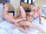 Golden-haired girlfriends actively rub shaved vaginas against each other on the soft carpet 9