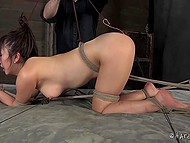 Asian bimbo is tied up and tortured by cruel freak in all possible ways and with different devices 5