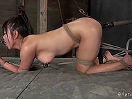 Asian bimbo is tied up and tortured by cruel freak in all possible ways and with different devices 9