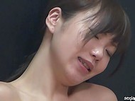 Teenage Japanese girl lies on the floor and becomes exhausted fingering her unshaven crotch 4