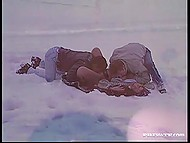 Provocative girl takes her clothes off and fucks two boys right in snow before going to the sauna 4