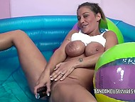 Dame with massive breasts masturbates using metallic vibrator in inflatable pool 6