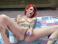 Tattooed redhead works out shaved pussy with vibrator to favorite rock music 10