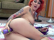 Tattooed redhead works out shaved pussy with vibrator to favorite rock music 4