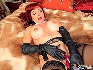 Adult woman in black gloves is using favorite vibrator that always helps her to get strong orgasms