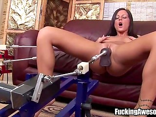 Brown-haired minx uses two drilldos to masturbate and simulate threesome sex