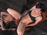 Dominator rubbed anus of tattooed slave with vibrator before she stuck it in her pussyhole 11