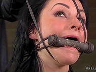 Bearded master with cap skilfully tied up submissive girl and put a piece of wood in mouth 10