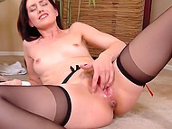 Red-haired minx laid down on the floor and amused pussy with dildo, vibrator, and fingers 9