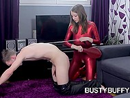 Dominating babe in red costume and high heels made submissive boy's dick cum to compensate his humiliation