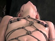 Lady is caught and tied up in a cellar with vibrator at pussy that brings lascivious torment to her 5