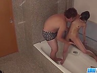 Hidden camera set in the bathroom filmed guy washing model's body and fingering her hairy pussy 11
