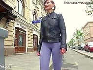 Tireless nympho in tight leggings demonstrates model gait before flashing her titties outdoors 4