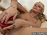 Imposing red dildo is light-haired dollface's favorite toy and she contrives to fit it in pierced pussy 4