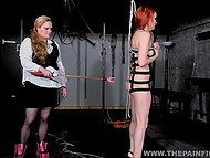 Dominant dame with tough face mercilessly slapped red-haired captive and took electric toy