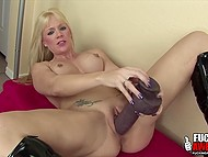 MILF in leather high boots thinks size matters and masturbates using only massive dildos 9