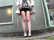 Shameless Japanese girls lift up skirts and flash sissies in the streets of Tokyo 8
