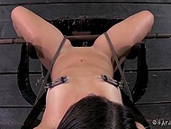 Dominating man put clamps on nipples of captive with gagged mouth and then came back with some toys 10