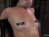 Dominating man put clamps on nipples of captive with gagged mouth and then came back with some toys 11