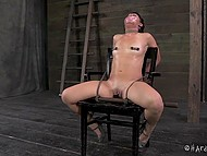 Dominating man put clamps on nipples of captive with gagged mouth and then came back with some toys 8
