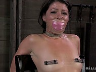 Dominating man put clamps on nipples of captive with gagged mouth and then came back with some toys 9