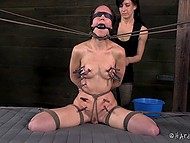Dominating gal put pins on bounded captive's body, hit with scourge and used powerful vibrator