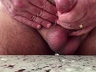 Buddy jerks off and makes cock erupt accumulated semen in slow motion 11