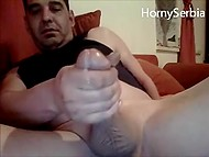 Male from Serbia strokes his imposing phallus and cums in front of webcam 9