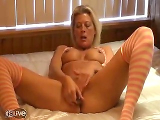 Excited Dutch MILF with big breasts impales her pierced pussy with new dildo in solo video
