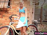 Despite the heat, young cyclist from Australia works out both holes with dildos in the yard 7