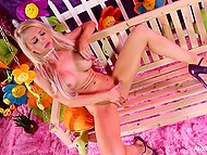 Dazzling Alix Lynx with splendid boobers sat down on the swing to pet the kitty 8