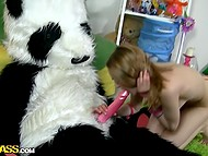 Lassie with pirate hat had taken some selfies before sat down on plushy panda's huge stick 7
