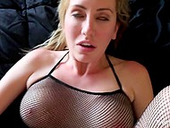 Smiling sweetie with big breasts and in fishnet bodystocking serves man's device 9