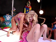 Blonde-haired stripper and clown performed pussylicking show in front of masked public
