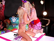 Blonde-haired stripper and clown performed pussylicking show in front of masked public 6