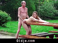 Minx made a pass at old man and he finally succumbed to temptation and fucked her outdoors 6
