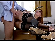 Red-haired secretary with meaty butt cheeks helped boss to relax on the office table 7