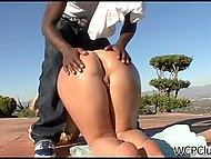 Chesty blonde Julie Cash with oiled butt cheeks enjoys great black rod in the open air 6