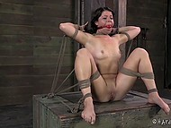 Black-haired prisoner gets tied up in dungeon and vicious man punishes her with adult toys 3