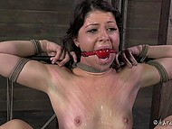 Black-haired prisoner gets tied up in dungeon and vicious man punishes her with adult toys 5