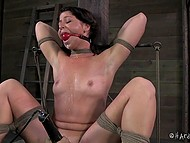 Black-haired prisoner gets tied up in dungeon and vicious man punishes her with adult toys 8