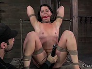 Black-haired prisoner gets tied up in dungeon and vicious man punishes her with adult toys 9