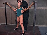 Bearded dominant man did a lot of things with tied up girl: slapped with flogger, hit the heels, and kneaded cunny with chrome toy 4