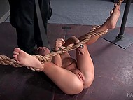Bearded dominant man did a lot of things with tied up girl: slapped with flogger, hit the heels, and kneaded cunny with chrome toy 6