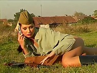 Slender model Evelyn Lory from Slovenia poses in green lingerie and Soviet soldier uniform 11
