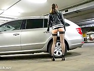 Adventurous Jeny Smith flashes shaved pussy and gambols with rubber penis in the underground parking 3
