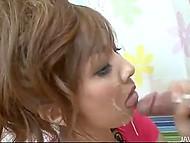 Японка работает ручками и ротиком, заставляя несколько хуйцов кончать ей на лицо 8