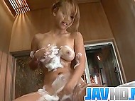 Japanese lass takes a shower soaping soft natural boobs and smooth-shaven cunny thoroughly 7